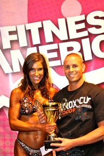 woman winner of fitness trophy with Brady Roberts